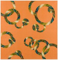 Jungle print fabric is used to create the rings on a muted orange background